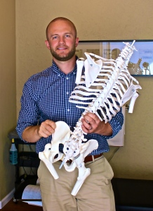 Dr. Dane Seitz holding model of skeletal system